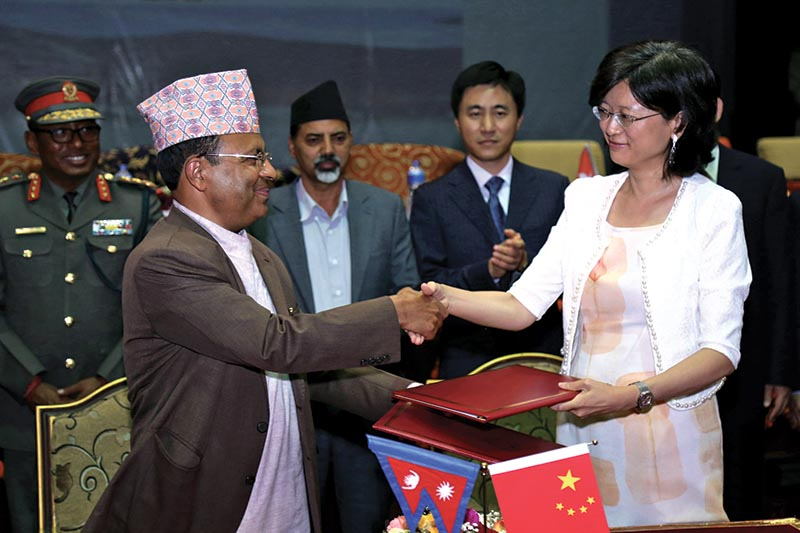 Secretary at the Ministry of Home Affairs Lok Darshan Regmi shaking hands with Chinese Ambassador to Nepal Yu Hong, in Kathmandu, on Friday, JUne 30, 2017. Photo: THT