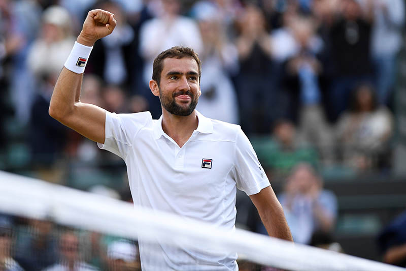 Croatiau2019s Marin Cilic celebrates winning the quarter final match against Luxembourgu2019s Gilles Muller. Photo: Reuters
