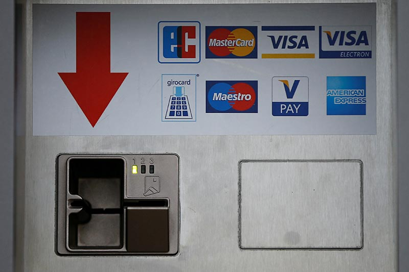 A card slot for various credit and payment cards (Eurocheque, Mastercard, Visa, Visa Electron, girocard, Maestro, V-Pay and American Express) is pictured in Duesseldorf, Germany, on April 7, 2016. Photo: Reuters/ File