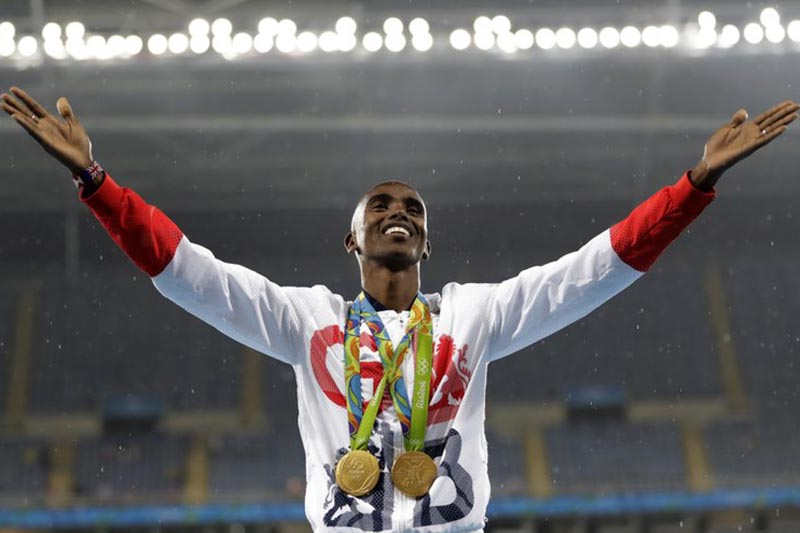 Britainu2019s Mo Farah celebrates winning the gold medal at the menu2019s 5000-meter medals ceremony, during the athletics competitions of the 2016 Summer Olympics at the Olympic stadium in Rio de Janeiro, Brazil, on August 20, 2016. Photo: AP