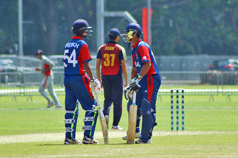 Nepali batsmen talk in the middle of crease during ICC U-19s World Cup Asia Qualifier in Singapore, on Monday, July 16, 2017. Photo: RSS