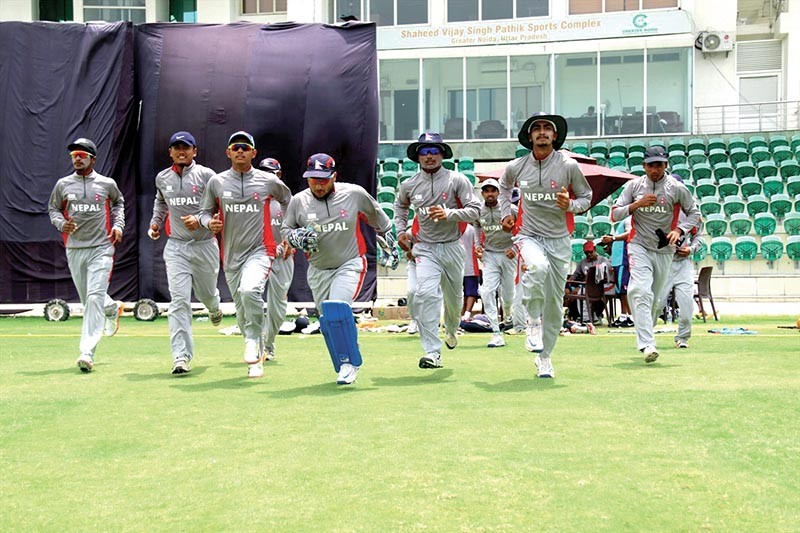 Nepali U-19 cricket team players enter the pitch for their practice match against RP Singh Academy at the Shaheed Vijay Pathik Sports Complex in Greater Noida, India, on Sunday. Photo Courtesy: Raman Shiwakoti