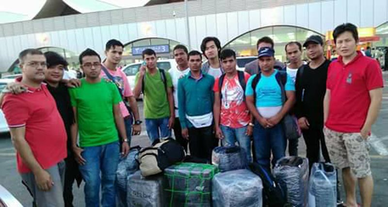 Stranded Nepali youths posing for a group photograph in Saudi Arabiau2019s airport before boarding a flight for home, on Monday, July 17, 2017. Photo: THT