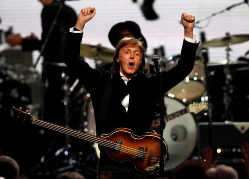 Paul McCartney celebrates after performing with Ringo Starr (not pictured) during the 2015 Rock and Roll Hall of Fame Induction Ceremony in Cleveland, US, on Ohio April 18, 2015. Photo: Reuters/ File