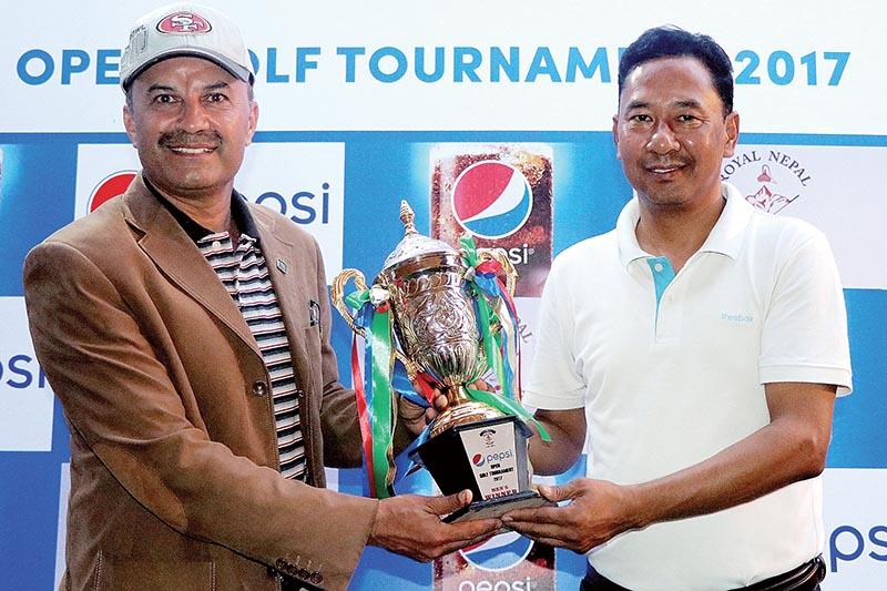 Territory Marketing Head of Varun Beverages Nepal Pvt Ltd Nishi Lama handing over the winneru2019s trophy to Col Bishnu Karki (left) after the Pepsi Open Golf Tournament at the Royal Nepal Golf Club in Kathmandu, on Saturday. Photo: THT