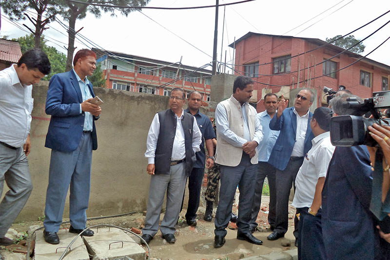 Minister for Urban Development Prabhu Sah listening to concerned authorites involved in the road expansion project along Tripureshwor-Naagdhunga road section in Kathmandu, on Monday, July 24, 2017. Photo: RSS