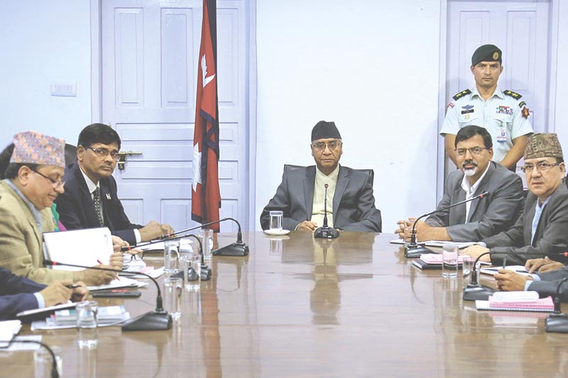 Prime Minister Sher Bahadur Deuba holding a meeting with Election Commission officials in Singha Durbar, Kathmandu, on Sunday, July 16, 2017. Photo: RSS
