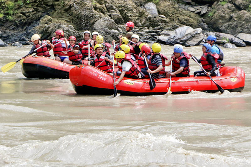 Tourists enjoy rafting at Trishuli River near Dhading on Tuesday, July 4, 2017. Photo: RSS