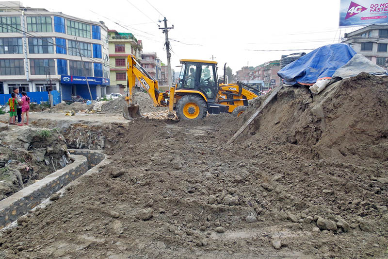 An excavator being used to expand road along Suryabinayak-Banepa-Dhulikhel, as captured on Tuesday, July 18, 2017. The road is being constructed under Japan aid. Photo: RSS