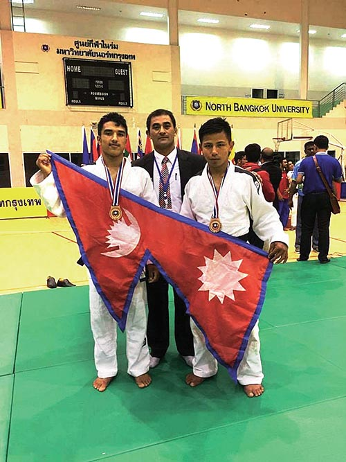 (From left) Indra Shrestha, coach Surya Narayan Shrestha and Umesh Magar after the Thailand International North Bangkok  University Judo Championship, on Sunday. Photo: THT