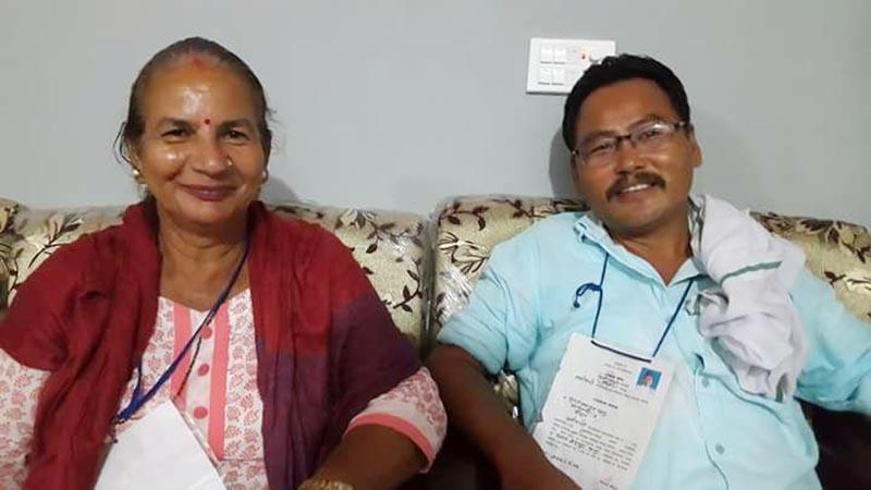 Newly elected mayor and deputy mayor of Urlabari Municipality Khadga Phago (right) and Laxmi Devi Bhandari from UML posing for a photo, in Morang, on Wednesday, July 5, 2017. Photo: THT
