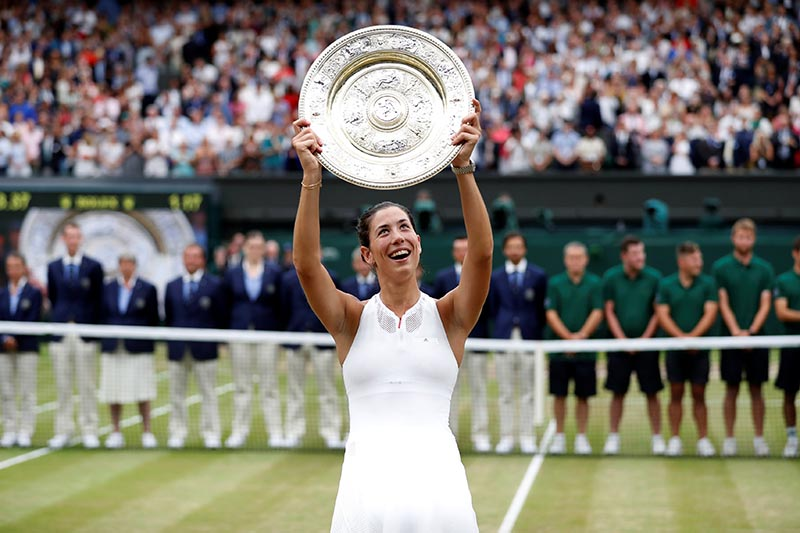 Spainu2019s Garbine Muguruza poses with the trophy as she celebrates winning the final against Venus Williams of the US, at Wimbledon, in London, Britain, on July 15, 2017. Photo: Reuters