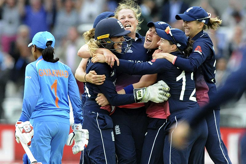 England's Anya Shrubsole, (centre), celebrates with teammates as England win the ICC Women's World Cup 2017 final match against India at Lord's in London, England, on Sunday, July 23, 2017. Photo: AP