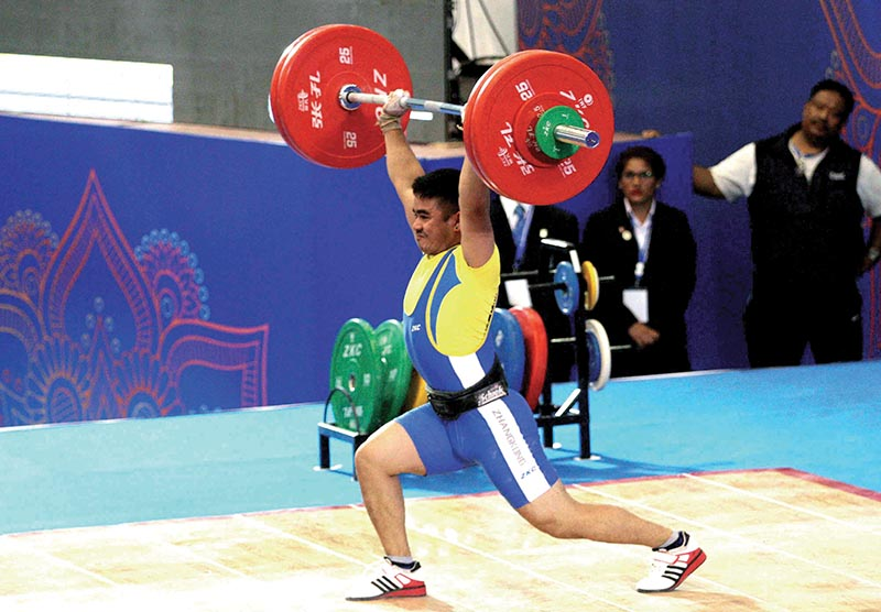 Nepalu2019s Prakash KC lifts weight during the Youth and Junior Asian Weightlifting Championships in Lalitpur on Wednesday. Photo: Udipt Singh Chhetry/ THT