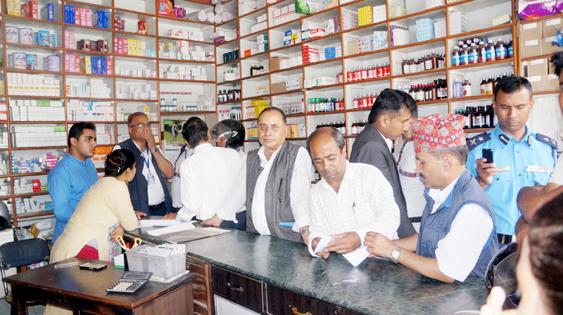 A market monitoring team mobilised from the District Market Monitoring Committee in Pokhara inspect a medicine shop, on Monday, July 24, 2017. Photo: Bharat Koirala