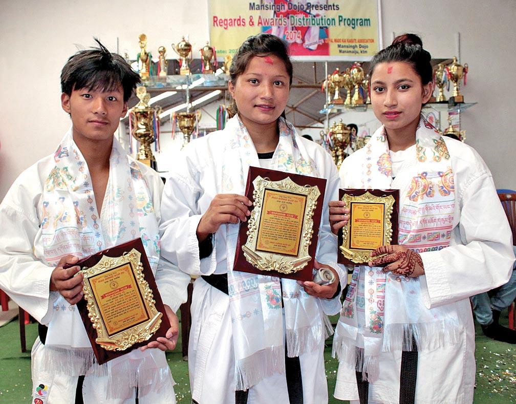 (From left) Ravi Tamang, Rupa Maharjan and Elina BK after being honoured by Mansingh Dojo in Kathmandu, on Saturday. Photo: THT