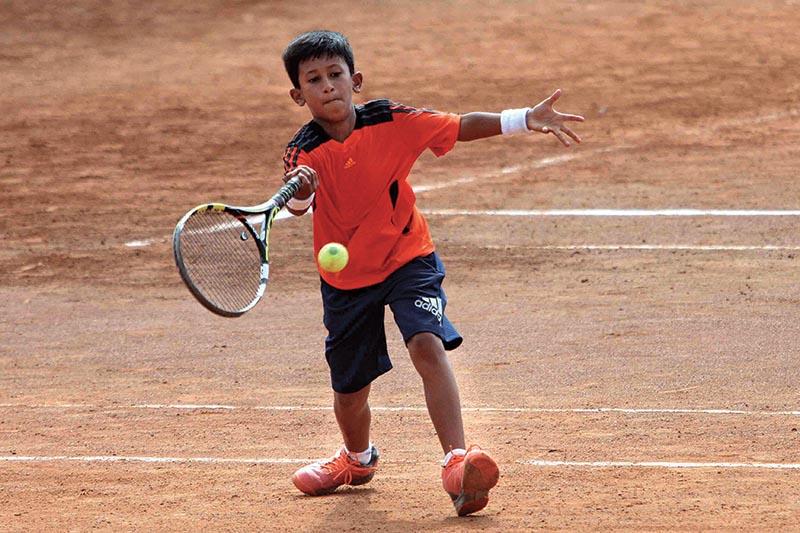 Pranav Manandhar returns to Sakshyam Bikram Shah during their ANLTA-JTI National Junior Tennis Tournament match in Lalitpur, on Monday. Photo: Udipt Singh Chhetry/ THT