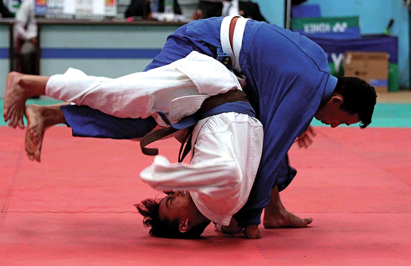 Roshan Bahadur Dong (left) of PAM fights against Dependra Tamang of Nepal APF Club during their menu2019s below-55kg bout of the eighth Ambika Bahadur Chhetri Memorial Open Judo Tournament in Lalitpur, on Saturday. Photo: Udipt Singh Chhetry/ THT