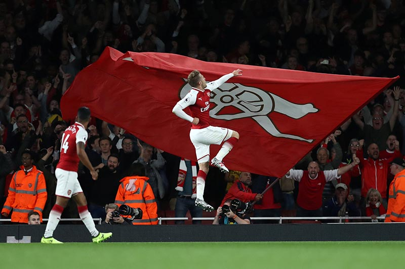 Arsenal's Aaron Ramsey celebrates scoring their third goal in Premier League match between Arsenal and Leicester City, in London, Britain, on August 11, 2017. Photo: Reuters