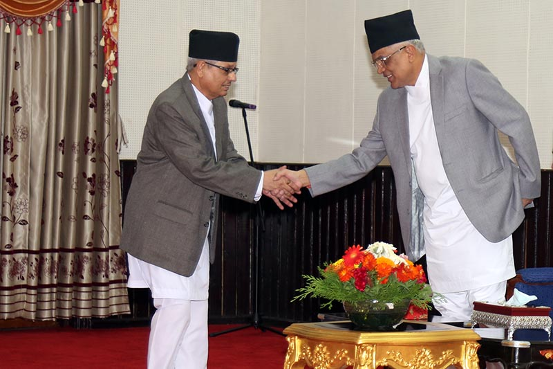 Chief Justice Gopal Parajuli offer congratulations to the newly appointed Attorney General Basanta Ram Bhandari after administering oath of office and secrecy to him in presence of President Bidya Devi Bhandari amid a ceremony held at the Office of President in Shital Niwas, on Friday, August 18, 2017. Photo: RSS.