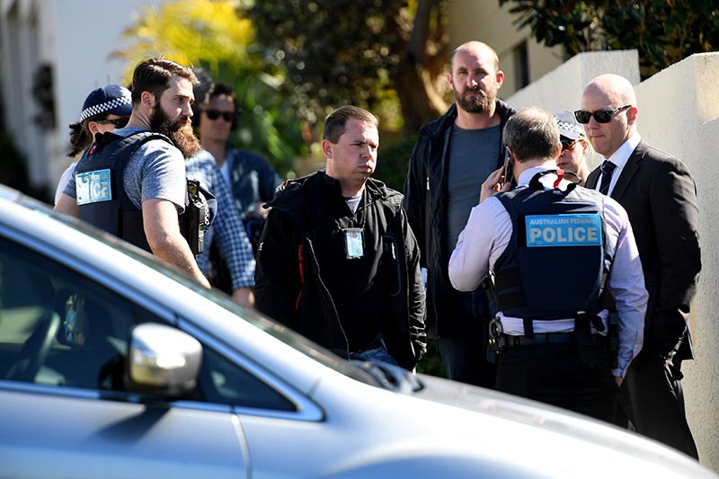 Police stand outside the home of John Ibrahim during a police operation in Sydney, Australia, on August 8, 2017. Photo: AAP/Brendan Esposito/via Reuters