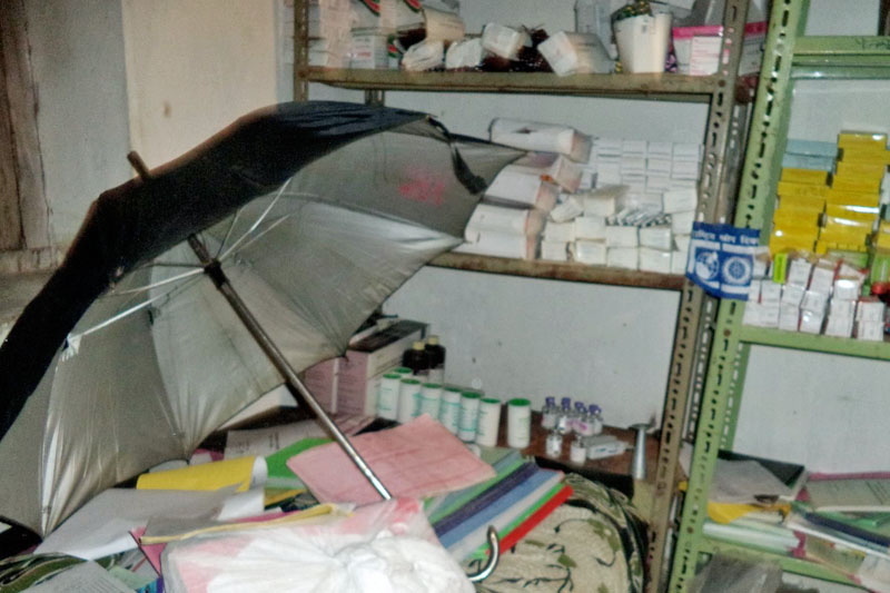 Umbrella being used to shield medicines and documents at a health post in Bajura district, on Wednesday, August 2, 2017. Photo: Prakash Singh