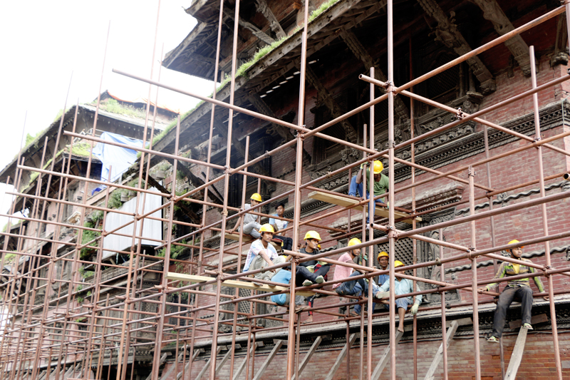 File - Labourers reconstruct the Basantapur Darbar Square area, in Kathmandu, on Tuesday, August 15, 2017. Photo: RSS