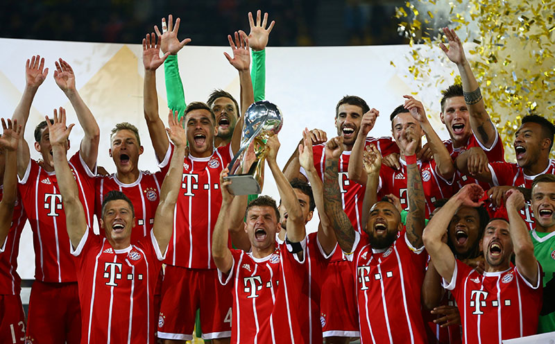 Bayern Munichu2019s Thomas Muller celebrates with the trophy after winning the DFL-Supercup Final. Photo: Reuters
