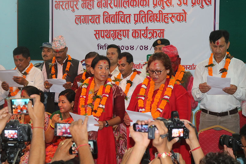 Newly elected local representatives being sworn-in by Chief Election Officer in Bharatpur, on Sunday, August 6, 2017. Photo: Tilak Ram Rimal