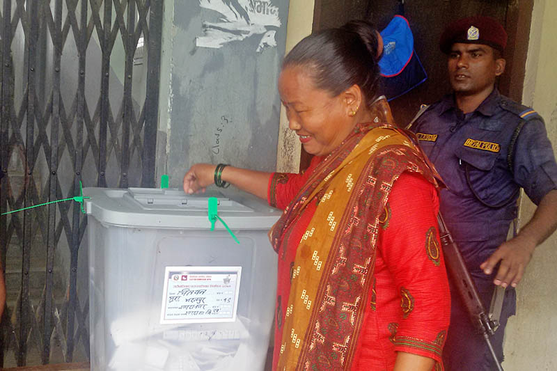A voter casting vote during re-polling of Bharatpur-19 in Chitwan district, on Friday, August 4, 2017. Photo: Tilak Ram Rimal