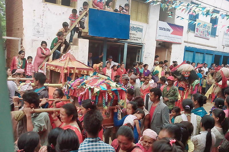 Locals throng to observe Shree Krishna Rath Yatra procession and Lakhe Naach in Bhojpur, district headquarters, on Tuesday, August 15, 2017. Photo: Niroj Koirala