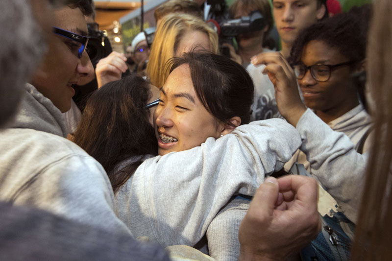 Schoolgirl Bivsi Rana, center, from Nepal  arrives to the airport in Dusseldorf, Germany, Wednesday, Aug. 2,  2017 and is hugged by friends. The German-born Nepalese girl who was taken from her school and deported from Germany two months ago has returned after authorities agreed to allow her back on a student exchange visa. Fifteen-year-old Bivsi Rana was welcomed by fellow students and supporters Wednesday at Duesseldorf Airport. Photo: AP
