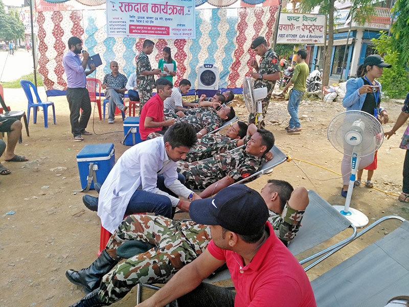 Army personnel donate blood during a blood donation campaign in Kawasati of Nawalparasi district, on Wednesday, August 9, 2017. Photo: Shree Ram Sigdel