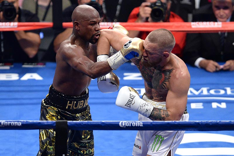 Floyd Mayweather Jr. (black trunks) and Conor McGregor (white trunks) box during the eighth round of their boxing match at T-Mobile Arena, in Las Vegas, NV, USA, on August 26, 2017. Photo: Joe Camporeale-USA TODAY Sports via Reuters
