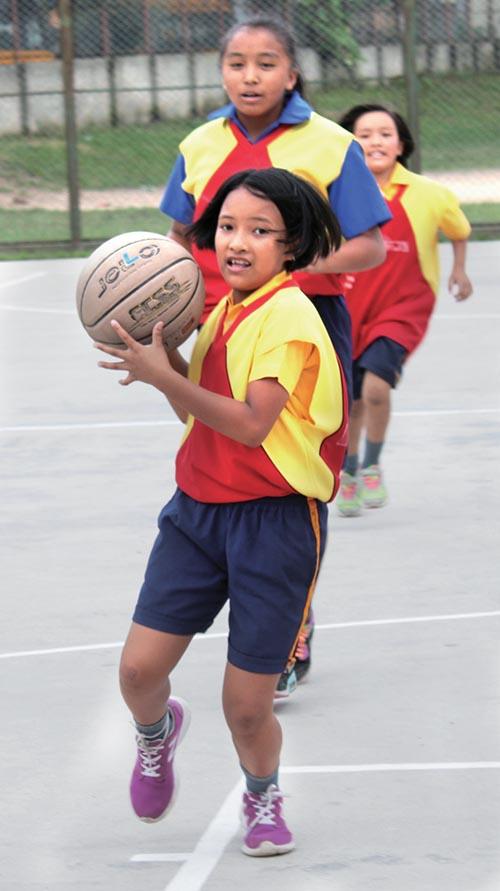 A Player of Shridiwa School drives the ball during the Brihaspati Cup Mini Basketball Tournament in Kathmandu, on Tuesday. Photo: THT