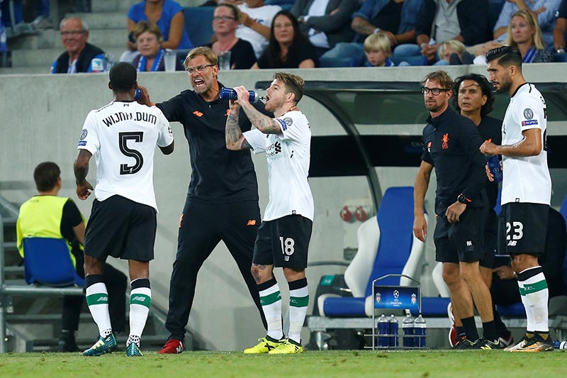 Liverpool manager Juergen Klopp with Liverpool's Georginio Wijnaldum and Alberto Moreno in Champions League  Qualifying Play-Off First Leg match between Hoffenheim and Liverpool, in Sinsheim, Germany, on August 15, 2017. Photo: Reuters