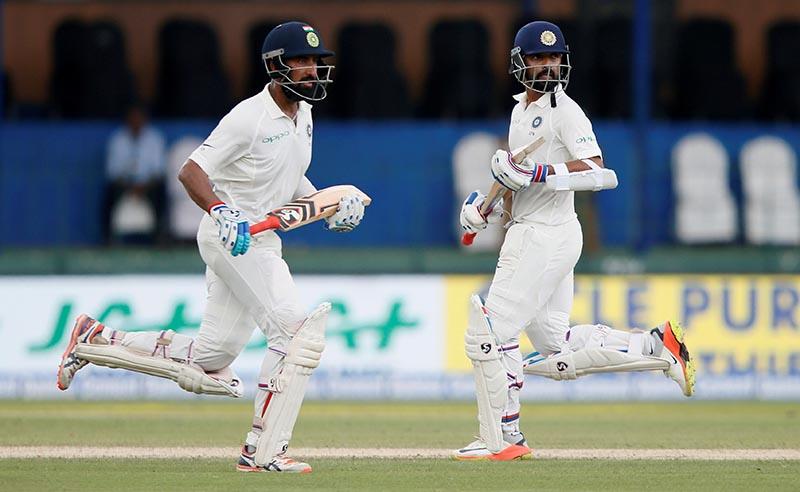 India's Cheteshwar Pujara and Ajinkya Rahane run between wickets. Photo: Reuters