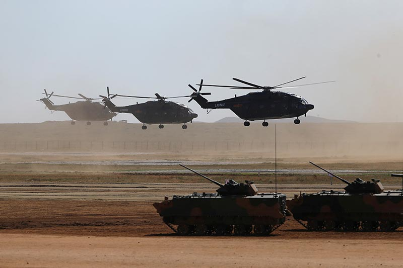 Helicopters and armoured vehicles participate in the military parade to commemorate the 90th anniversary of the foundation of the China's People's Liberation Army (PLA) at Zhurihe military training base in Inner Mongolia Autonomous Region, China, on July 30, 2017. Photo: Reuters