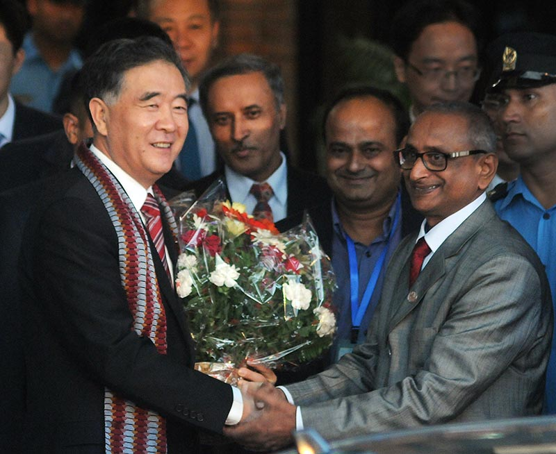 Vice-premier of the State Council of  China Wang Yang (left) shaking hands with Minister of Culture, Tourism and Civil Aviation Jitendra Narayan Dev at Tribhuvan International Airport, Kathmandu, on Monday, August 14, 2017. Photo: Balkrishna Thapa Chhetri/THT