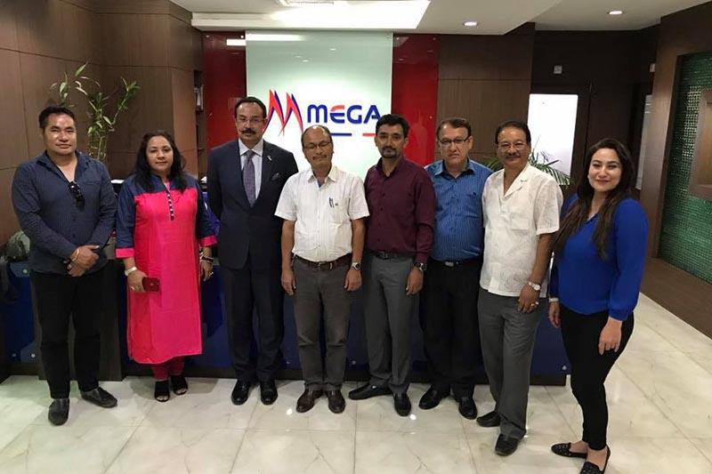 Officials of NRNA Thailand and Mega Bank pose for a photograph. Photo Courtesy: NRNA Thailand