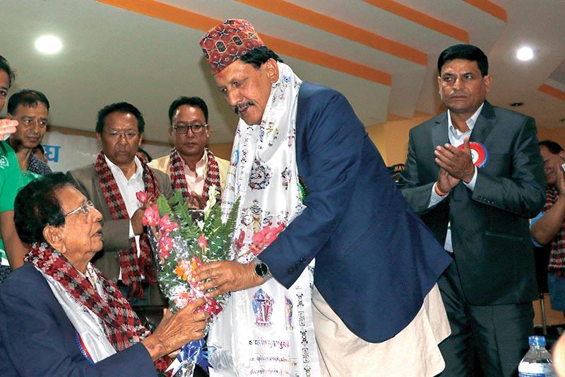 Minister for Youth and Sports Rajendra Kumar KC (left) felicitating  former president of Cricket Association of Nepal Jay Kumar Nath Shah, during the Special General Assembly of CAN, in Kathmandu, on Tuesday. Photo: THT
