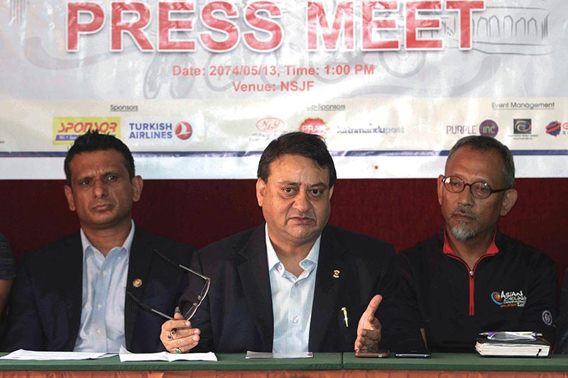 Lions Club International's GMT Area Leader Khagendra Sitaula Speaks as event Coordinator Kishor Bhattarai (left) and President  of Nepal Cycling Association Chimmi Gurung (right) look on during a press meet on Tuesday. Photo: THT