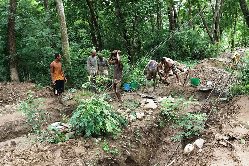 Locals are seen working for the construction of a suspension bridge in Kanchanpur district, on Friday, August 11, 2017. Photo: RSS