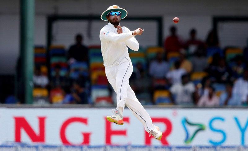 Sri Lanka's captain Dinesh Chandimal throws the ball. Photo: Reuters