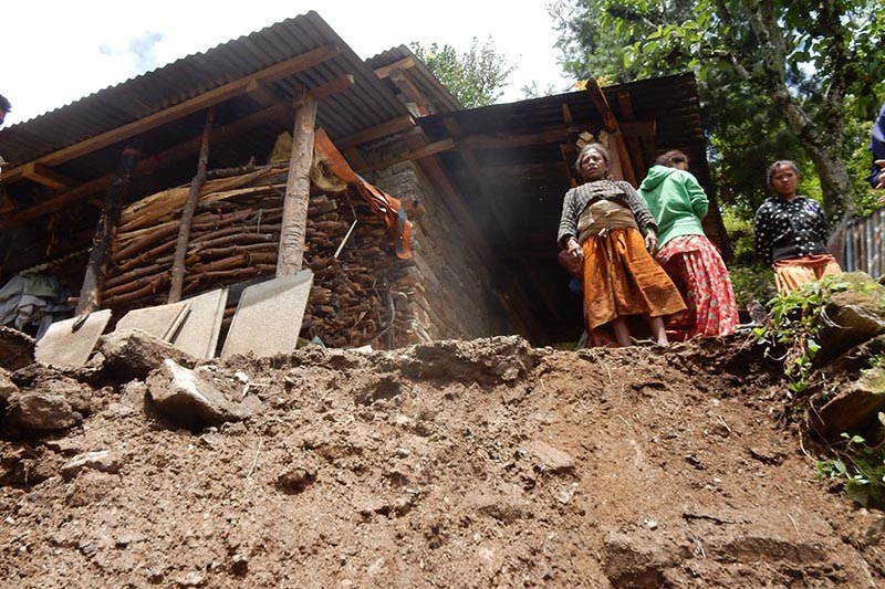 Local women observing a landslide that occurred at Kutkute of Bhimeshwor Municipality, in Dolakha, on Thursday, August 10, 2017. Photo: THT