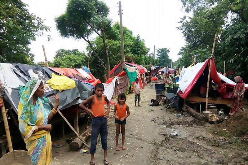 Flood survicors standing outside their makeshift tents in Durga Bhagawati Rural Municipality, in Rautahat district, Friday, August 18, 2017. Photo: THT