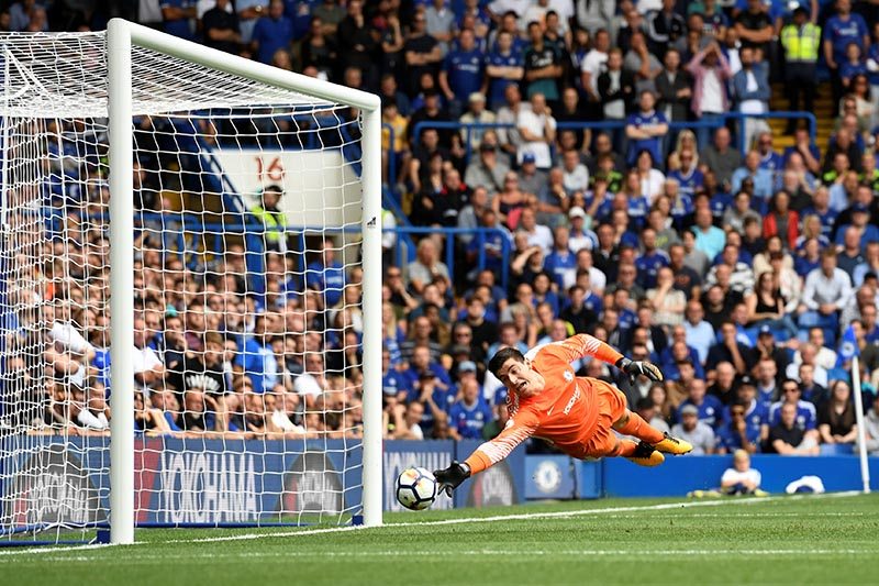 Chelsea's Thibaut Courtois looks on as Burnley's Sam Vokes scores a goal which is later disallowed in the Premier League match between Chelsea and Burnley, in London, Britain, on August 12, 2017. Photo: Action Images via Reuters