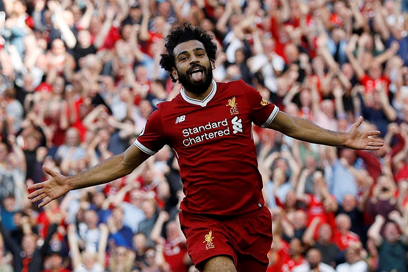 Liverpool's Mohamed Salah celebrates scoring their third goal during the Premier League match between Liverpool and Arsenal, in Liverpool, Britain, on Sunday, August 27, 2017. Photo: Reuters