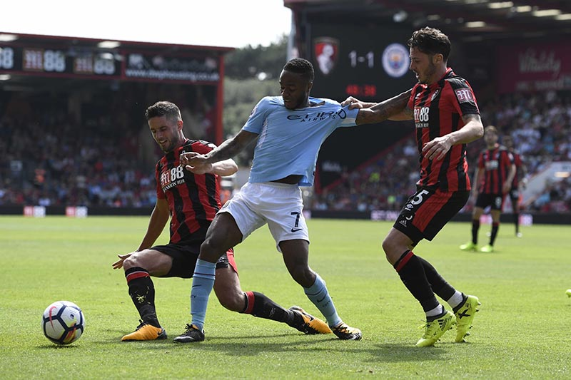 Manchester City's Raheem Sterling in action with Bournemouth's Adam Smith and Andrew Surman in the Premier League match between AFC Bournemouth and Manchester City, in Bournemouth, Britain, on August 26, 2017. Photo: Reuters