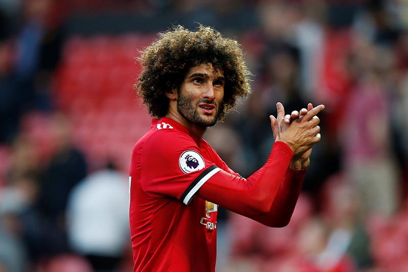 Manchester United's Marouane Fellaini applauds fans after the Premier League match between Manchester United and Leicester City, in Manchester, Britain, on August 206, 2017. Photo: Reuters